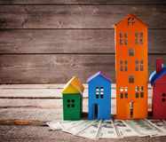paper houses stands over a wooden background Stock Image