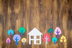 Paper houses and trees, home environment Stock Photos