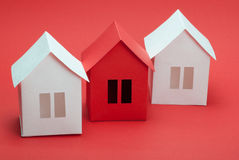 Paper houses. White and red paper houses on red background Stock Photo