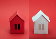 Paper houses. White and red paper houses on red background Royalty Free Stock Image