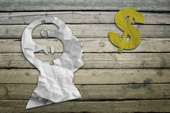 Paper humans head with dollar symbol Royalty Free Stock Images