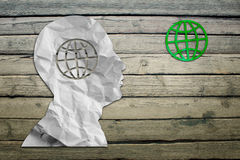 Paper humans head with globe symbol Royalty Free Stock Image