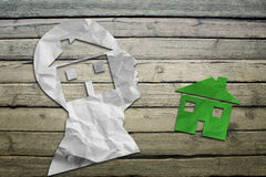 Paper humans head with house symbol Stock Images