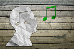 Paper humans head with musical symbol Royalty Free Stock Photo