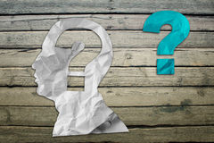 Paper humans head with question symbol Stock Photo