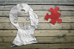 Paper humans head with red puzzle symbol Royalty Free Stock Image