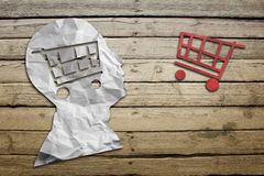 Paper humans head with shopping cart symbol Royalty Free Stock Images