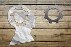 Paper humans head with wheel symbol Stock Photo
