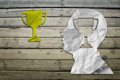 Paper humans head with winner cup symbol Stock Photography