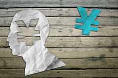 Paper humans head with yen symbol Stock Photos