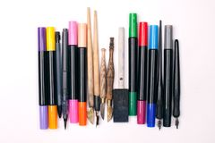 Paper, ink and calligraphy pens. Lettering workshop details.  Royalty Free Stock Photos