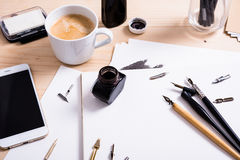 Paper, ink and calligraphy pens. Lettering workshop details royalty free stock photos