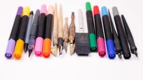 Paper, ink and calligraphy pens. Lettering workshop details. Banner Concept, Design Copy Space Supplies Top View Flat Lay. Paper, ink and calligraphy pens Stock Images