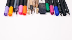 Paper, ink and calligraphy pens. Lettering workshop details. Banner Concept, Design Copy Space Supplies Top View Flat Lay.  Royalty Free Stock Images