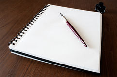 Paper ink and pen. Empty paper with a pen on top and ink in the background Royalty Free Stock Photos