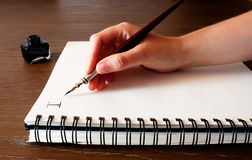 Paper ink and pen. Empty paper with a pen and ink in the background Royalty Free Stock Image