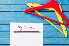Paper with inscription and hangers Royalty Free Stock Image
