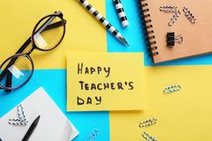 Paper with inscription HAPPY TEACHER`S DAY Stock Images