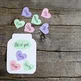 Paper jar with hearts and text Best gift. Colored paper hearts with wishes. Greeting card made of colored paper and cardboard Royalty Free Stock Image