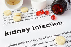 Paper with kidney infection and pills. Stock Photo