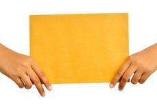 paper kvinnayellow för hand royaltyfri fotografi