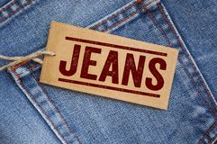 Label on a blue jeans with denim royalty free stock photo