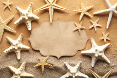 Paper label and starfishes on the beach Royalty Free Stock Photos