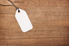 Paper label tag on wood Stock Images