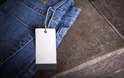 Paper label. White paper label on blue jean Stock Photography