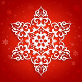 Paper lace doily. White paper snowflake, lace doily, winter decoration on red background royalty free illustration