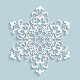 Paper lace snowflake. Paper snowflake, lace doily, winter decoration Stock Photo