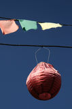 Paper lantern. Hangs from a wire against a blue sky Royalty Free Stock Image