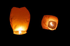 Paper lanterns on black background. View from rear and low angle view Royalty Free Stock Images