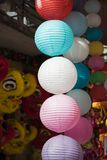 Paper lanterns for sale on Hang Ma street. The street are crowded before Vietnamese Mid-Autumn Festival for children who receive t. Oys, fruit and moon cake as Stock Photo