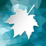 Paper leaf over geometric background. Paper 3d maple leaf over blue abstract geometric triangular background Royalty Free Stock Photos