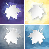 Paper leaves over geometric background. Set of paper 3d maple leaves over abstract geometric triangular background Royalty Free Stock Photo