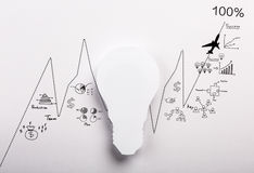 Paper Light bulb with drawing graph Stock Photo