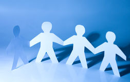 Paper little men holding hands. Team concept Royalty Free Stock Photos