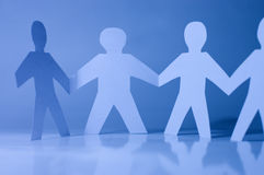 Paper little men holding hands. Team concept Royalty Free Stock Photography