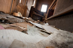 Paper On Livingroom Floor. Trashed room in an old abandoned house Stock Photo