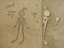 Paper in love. Illustration with cutout  technique. Textured  brown paper Stock Photos