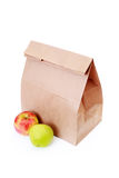 Paper lunch bag. With fresh apples on white - food and drink Royalty Free Stock Photo