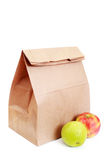 Paper lunch bag. With fresh apples on white - food and drink Royalty Free Stock Image