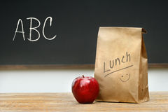 Paper lunch bag on desk Royalty Free Stock Image