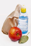 Paper lunch bag with red apple Royalty Free Stock Photo