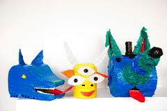 Paper-mache decorative magic animals. Colorful artistic heads of fantastic animals made with carton and tape composed in set Royalty Free Stock Photo