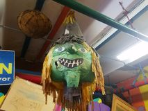 Paper Mache witch haloween head. Paper Mache green head hanging from the rafters Stock Images