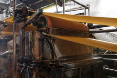 The paper machine in the factory royalty free stock photography