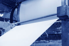 The paper machine in the factory are making paper royalty free stock images