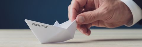 Free Paper Made Origami Boat With Persistence Sign Royalty Free Stock Image - 159295606